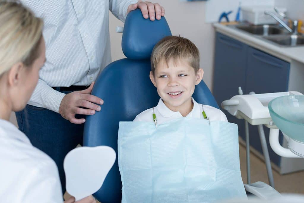little boy being brave with a dentist