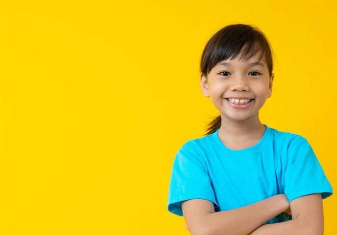 smiling-girl-yellow-background